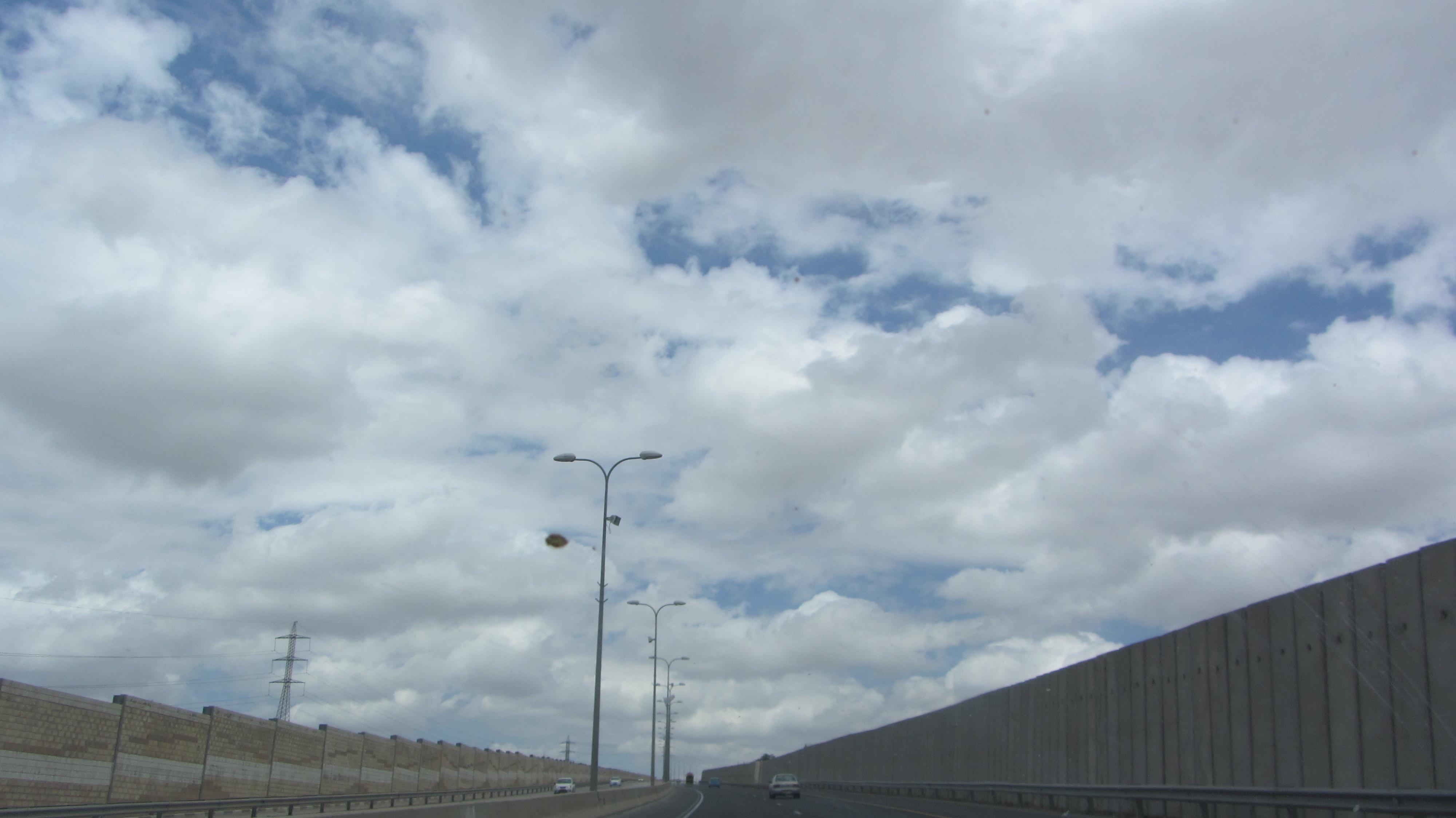 Clouds in sky over open road outside Jerusalem Israel