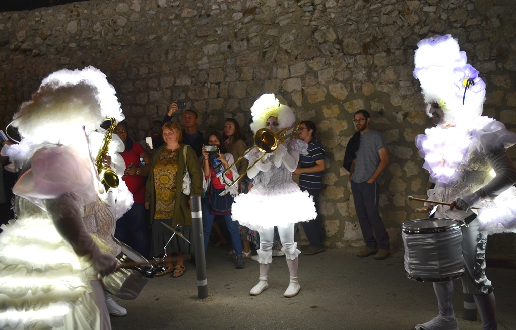 Jerusalem light festival people in light costumes