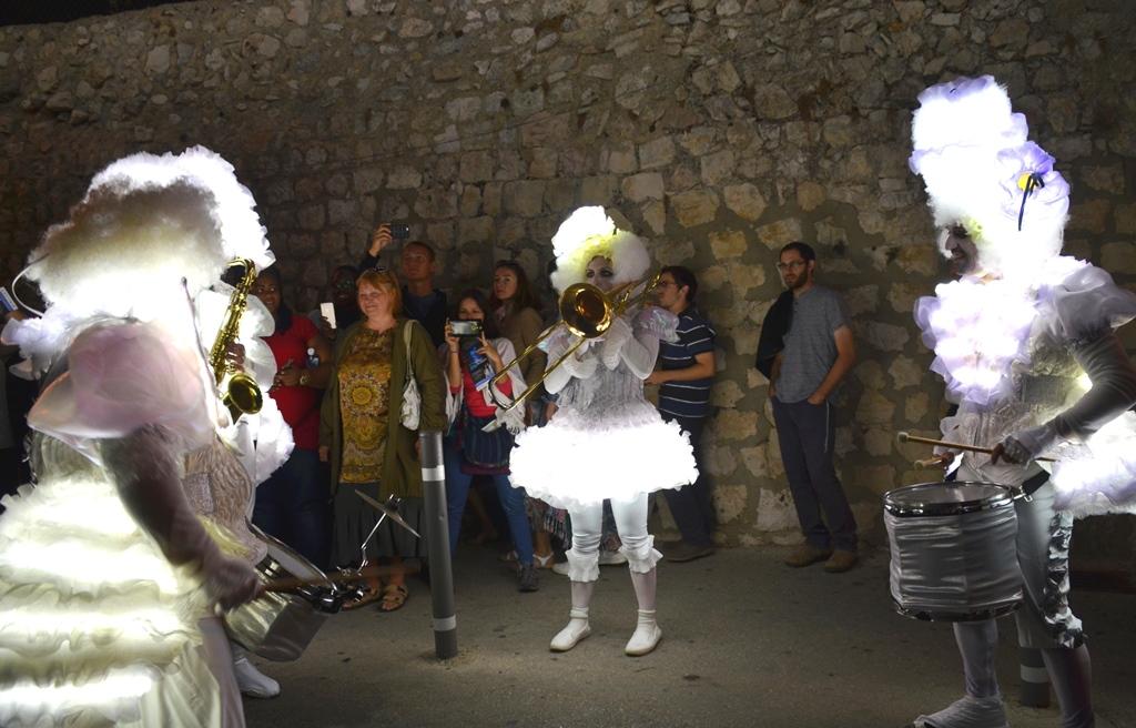 Jerusalem light festival people in light costumes
