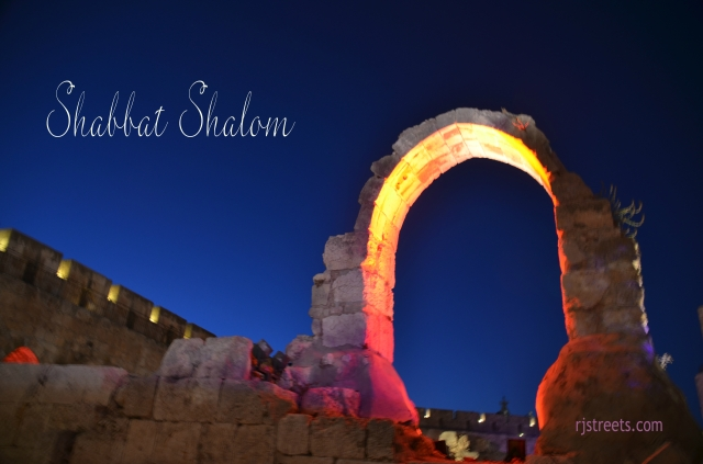 Shabbat shalom poster from arc at Tower of David lit at night