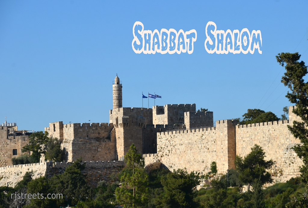 Shsbbat shalom as sun sets against walls of Old City