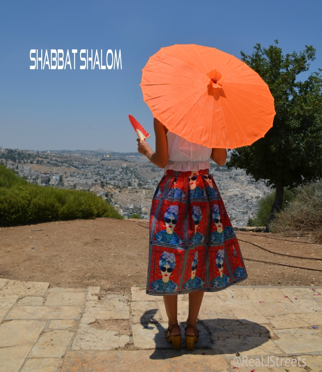 Shabbat shalom poster scene of Old City from Tayelet with young woman with orange umbrella