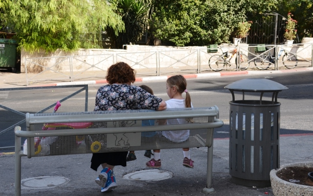 waiting for bus, woman and grandchildren