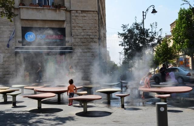 kids playing in water in Jerusalem