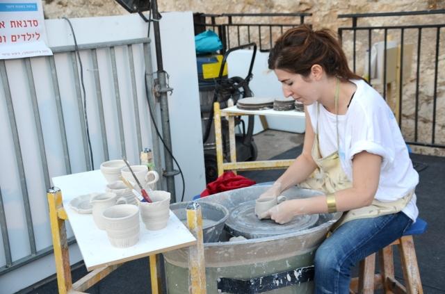 Making ceramic piece at arts fair