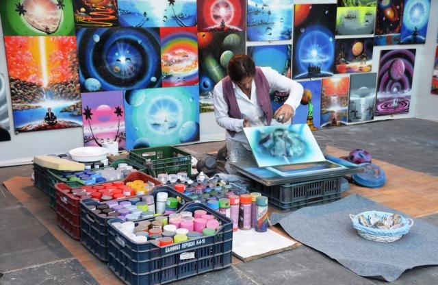 Spray paint artist at fair Jerusalem Israel