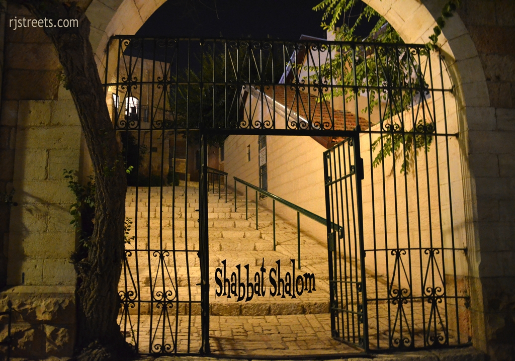 Shabbos poster gate Yemin Moshe at night