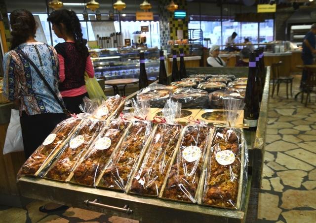 Berman Bakery in shuk with honey cake display for Rosh Hasahanna