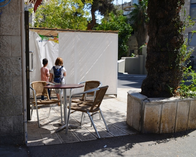 sukka outside of pizza shop Jerusalem